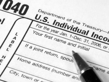 a 1040 tax form being filled out